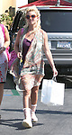 .. 6-25-09.Britney Spears out and about in Calabasas California shopping at M Fredric for kids with her assistant and body guard.  Wearing Hot pink purse & boots ...  AbilityFilms@yahoo.com.805-427-3519.www.AbilityFilms.com.