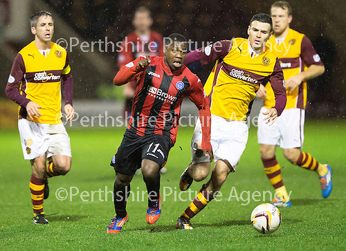 Motherwell v St Johnstone.....01.01.14   SPFL<br /> Nigel Hasselbaink and Stuart Carswell<br /> Picture by Graeme Hart.<br /> Copyright Perthshire Picture Agency<br /> Tel: 01738 623350  Mobile: 07990 594431
