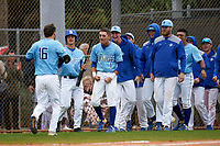 Indiana State Sycamores Brandt Nowaskie (16) is congratulated by teammates, including Dominic Cusumano (8), Jordan Schaffer (1), Tyler Grauer, after a home run during a game against the Dartmouth Big Green on February 21, 2020 at North Charlotte Regional Park in Port Charlotte, Florida.  Indiana State defeated Dartmouth 1-0.  (Mike Janes/Four Seam Images)