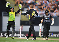 Ashton Agar celebrates the wicket of Williamson with Austrlalian keeper Alex Carey.<br /> New Zealand Black Caps v Australia.Tri-Series International Twenty20 cricket final. Eden Park, Auckland, New Zealand. Wednesday 21 February 2018. &copy; Copyright Photo: Andrew Cornaga / www.Photosport.nz