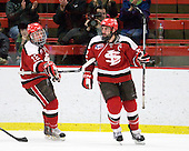Max Mobley (St. Lawrence - 12) and Aaron Bogosian (St. Lawrence - 32) celebrate Bogosian's goal which made it 4-2 Harvard midway through the third period. - The Harvard University Crimson defeated the St. Lawrence University Saints 4-3 on senior night Saturday, February 26, 2011, at Bright Hockey Center in Cambridge, Massachusetts.