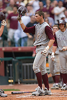 Luke Anders #44 of the Texas A&M Aggies is congratulated at home plate by his teammates following his 2-run home run versus the UC-Irvine Anteaters in the 2009 Houston College Classic at Minute Maid Park February 27, 2009 in Houston, TX.  The Aggies defeated the Anteaters 9-2. (Photo by Brian Westerholt / Four Seam Images)