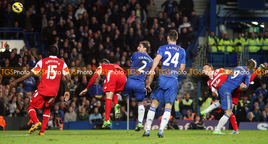 Branislav Ivanovic of Chelsea gets in a header on goal - Chelsea vs Queens Park Rangers, Barclays Premier League at Stamford Bridge, Chelsea - 02/01/13 - MANDATORY CREDIT: Rob Newell/TGSPHOTO - Self billing applies where appropriate - 0845 094 6026 - contact@tgsphoto.co.uk - NO UNPAID USE.