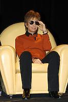 MICHAEL CIMINO.Travel in the American cinema, Park of Music, .Auditorium Rome, Italy, April 14th 2007..full length sunglasses orange jumper top black shirt sitting.CAP/CAV.©Luca Cavallari/Capital Pictures.