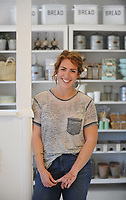 NWA Democrat-Gazette/ANDY SHUPE<br /> Natalie Freeman is the owner of the newly opened Freckled Hen Farmhouse Thursday, May 25, 2017, in south Fayetteville which she calls a modern general store.