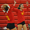 Emily Barry #16 of Sacred Heart Academy, right, reacts after a point in the first set of a CHSAA varsity girls volleyball match against host St. John the Baptist High School in West Islip on Thursday, Oct. 12, 2017. Sacred Heart won the match 3-0.