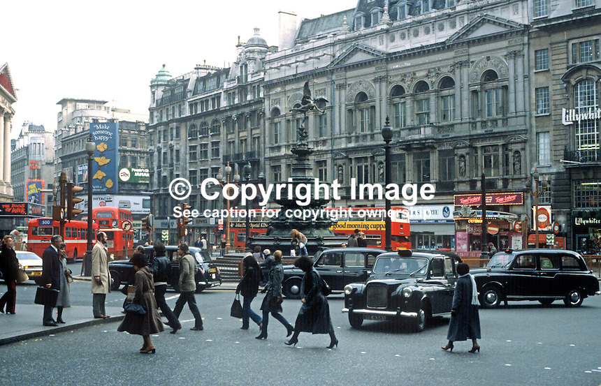 Picadilly Circus, London, UK, taxi, theatres, pedestrians, 198101000038PC4..Copyright Image from Victor Patterson, 54 Dorchester Park, Belfast, United Kingdom, UK...For my Terms and Conditions of Use go to http://www.victorpatterson.com/Victor_Patterson/Terms_%26_Conditions.html