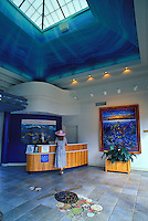 A visitor stands at the information/entrance booth inside the Maui Ocean Center in Maalaea town.