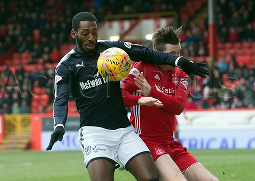 17th March 2018, Pittodrie Stadium, Aberdeen, Scotland; Scottish Premier League football, Aberdeen versus Dundee; Roarie Deacon of Dundee battles for the ball with Kenny McLean of Aberdeen