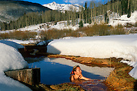 An invigorating early morning bathe in the hot springs surrounded by snow and with the backdrop of the Colorado Rockies