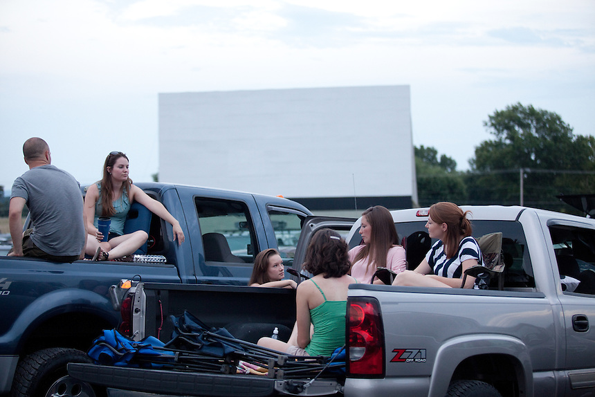 Friends hang out before the movie begins at Family Drive-In Theatre in Stephens City, Virginia on July 20, 2013. From left to right: Billy Paxtion of Broadway, VA (back turned), Brittany Palmer of Mt. Jackson, VA, Savannah Frazier of New Market, VA, Rachel Paxton of New Market, VA (back turned), Paige Frazier and  Molly Frazier of New Market, VA. CREDIT: Lance Rosenfield/Prime