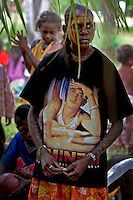 Young woman wears a modern day t shirt during a traditional cleansing ceremony on Tiwi Islands. <br /> A cleansing ceremony is the final ceremony in the death of a family member in the indigenous community.