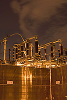THIS IMAGE IS AVAILABLE EXCLUSIVELY FROM GETTY IMAGES.....Please search for image # 200535111-001 on www.gettyimages.com....Electric Power Transformers and Fence Illuminated at Night, The DUMBO neighborhood of Brooklyn, New York City, New York State, USA