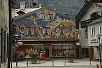 Mural painted on wall showing amazing ornate artwork tromp l'oeil on this shop facade. Oberammergau, Bavaria, Germany.
