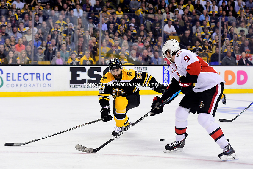 Monday, April 17, 2017: Boston Bruins defenseman Tommy Cross (56) tries checking Ottawa Senators right wing Bobby Ryan (9) during game 3 of round one of the National Hockey League Eastern Conference Stanley Cup Playoffs between the Ottawa Senators and the Boston Bruins, held at TD Garden, in Boston, Mass. Ottawa defeats Boston 4-3 in overtime and leads the series 2-1. Eric Canha/CSM
