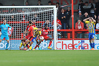 Paddy Lacey of Accrington Stanley (17) in a oal mouth scramble and Terry Gornell of Accrington Stanley (9) holds his head in his hands  during the Sky Bet League 2 match between Crawley Town and Accrington Stanley at Broadfield Stadium, Crawley, England on 22 October 2016. Photo by Edward Thomas / PRiME Media Images.