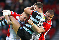 Picture by Alex Whitehead/SWpix.com - 01/05/2014 - Rugby League - First Utility Super League - St Helens v London Broncos - Langtree Park, St Helens, England - London's Alex Foster is tackled by St Helens' Luke Walsh and Josh Jones.