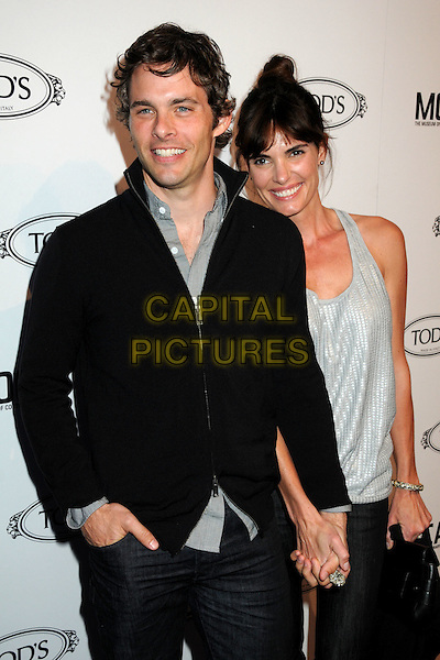 JAMES MARSDEN & LISA LINDE .TOD's Beverly Hills Boutique Launch Celebration held at TOD's Boutique, Beverly Hills, California, USA, .15th April 2010..half length black jacket sweater hand in pocket husband wife holding hands grey gray shirt vest top smiling jeans .CAP/ADM/BP.©Byron Purvis/AdMedia/Capital Pictures.