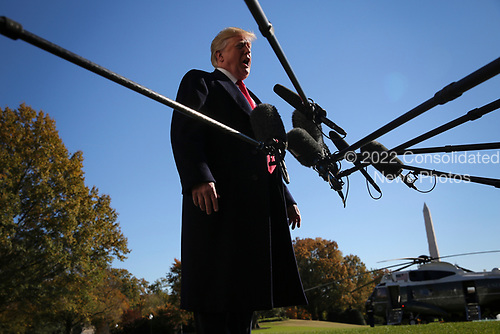 United States President Donald J. Trump talks to reporters before boarding Marine One on the South Lawn of the White House on November 4, 2018 in Washington, DC. <br /> Credit: Oliver Contreras / Pool via CNP