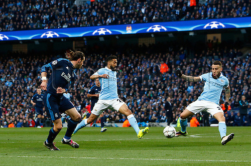 26.04.2016. The Etihad, Manchester, England. UEFA Champions League. Manchester City versus Real Madrid. Real Madrid's Welsh midfielder Gareth Bale's cross is blocked by City defenders Otamendi and Clichy.