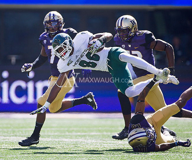 Nnamdi Agude gets tripped up by Husky defensive back Kevin King.