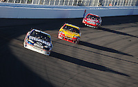 Mar 2, 2008; Las Vegas, NV, USA; NASCAR Sprint Cup Series driver Dale Earnhardt Jr (88) leads Kevin Harvick (29) and Carl Edwards (99) during the UAW Dodge 400 at Las Vegas Motor Speedway. Mandatory Credit: Mark J. Rebilas-US PRESSWIRE