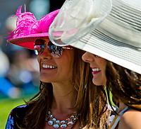 LEXINGTON, KENTUCKY - APRIL 08: Women wear fancy hats by the paddock on Blue Grass Stakes Day at Keeneland Race Course on April 8, 2017 in Lexington, Kentucky. (Photo by Scott Serio/Eclipse Sportswire/Getty Images)