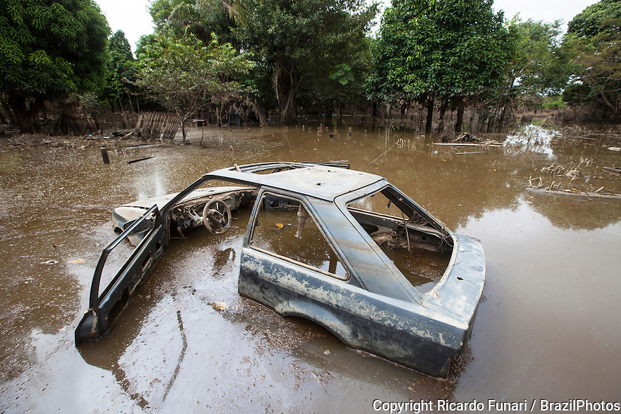 2015 flooding in Brazilian Amazon, destroyed car abandoned in flooded street at Taquari district, Rio Branco city, Acre State. Floods have been affecting thousands of people in the state of Acre, northern Brazil, since 23 February 2015, when some of the state's rivers, in particular the Acre river, overflowed. Further heavy rainfall has forced river levels higher still, and on 03 March 2015 Brazil's federal government declared a state of emergency in Acre State, where current flood situation has been described as the worst in 132 years. One of the worst affected areas is the state capital, Rio Branco, where level of the Acre River reached a record 18.40 meters in early March 2015. Flood stage is thought to be 14 meters.