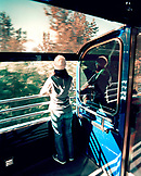 USA, Alaska, Anchorage, a young woman rides the train from Anchorage to Denali National Park