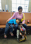 Mirna Vasquez and her daughter Catarin, refugees from El Salvador, sit in the airport in San Antonio, Texas, on December 2, 2015. The two fled their country to escape gang-related violence. After requesting political asylum in the United States, they were held for several days by immigration officials and then released, although Vasquez was forced to wear an ankle monitor. They stayed briefly in a shelter run by the Refugee and Immigrant Center for Education and Legal Services (RAICES) and supported by a coalition of San Antonio churches, then flew to another location in the U.S. while they await a final decision on their asylum petition.