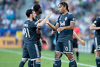 CARSON, CA - SEPTEMBER 29: Russell Teibert #31 and Theo Bair #50 of the Vancouver Whitecaps celebrate during a game between Vancouver Whitecaps and Los Angeles Galaxy at Dignity Health Sports Park on September 29, 2019 in Carson, California.