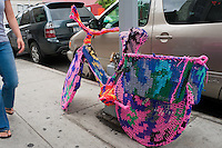 New York, NY -  10 July 2010 - The Knitted Bike by  artist Magda Sayeg, founder of Knitta Please in Nolita.   According to Sayeg, this new approach to knitting questions the assumptions of a traditional craft while adding a previously unused material to the world of street art. When Magda Sayeg began Knittaplease in 2005, it was her response to the dehumanizing qualities of an urban environment. By inserting handmade art in a landscape of concrete and steel, she adds a human quality that otherwise rarely exists. Knittaplease represents the present energy coming from knitting and more extensively weaving, while giving a nod to its powerful history. Her work has been recognized for its influence in street art as well as the craft of knitting. Magda Sayeg is based in Austin, Texas