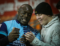 Wycombe Wanderers' Adebayo Akinfenwa poses for selfies with fans<br /> <br /> Photographer Alex Dodd/CameraSport<br /> <br /> Checkatrade Trophy Round 3 Blackpool v Wycombe Wanderers - Tuesday 10th January 2017 - Bloomfield Road - Blackpool<br />  <br /> World Copyright &copy; 2017 CameraSport. All rights reserved. 43 Linden Ave. Countesthorpe. Leicester. England. LE8 5PG - Tel: +44 (0) 116 277 4147 - admin@camerasport.com - www.camerasport.com