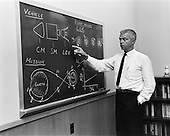 Langley Research Center, VA - (FILE) -- John C. Houbolt at blackboard, showing his space rendezvous concept for lunar landings on July 24, 1962. Lunar Orbital Rendezvous (LOR) would be used in the Apollo program. Although Houbolt did not invent the idea of LOR, he was the person most responsible for pushing it at NASA..Credit: Bob Nye - NASA via CNP