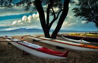 Outrigger canoes on beach. Hanakaoo Beach Park (Canoe Beach).  Lanai in background. Maui, Hawaii