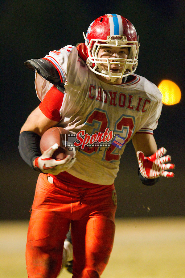 Steven Bevilacqua (32) of the Charlotte Catholic Cougars breaks away to score a touchdown in the second half against A.L. Brown at A.L. Brown High School on November 26, 2010 in Kannapolis, North Carolina.  The Cougars defeated the Wonders 45-7.  (Brian Westerholt/Sports On Film)