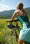 A young woman rests while mountain biking in the Cache Creek area near Jackson, Wyoming.