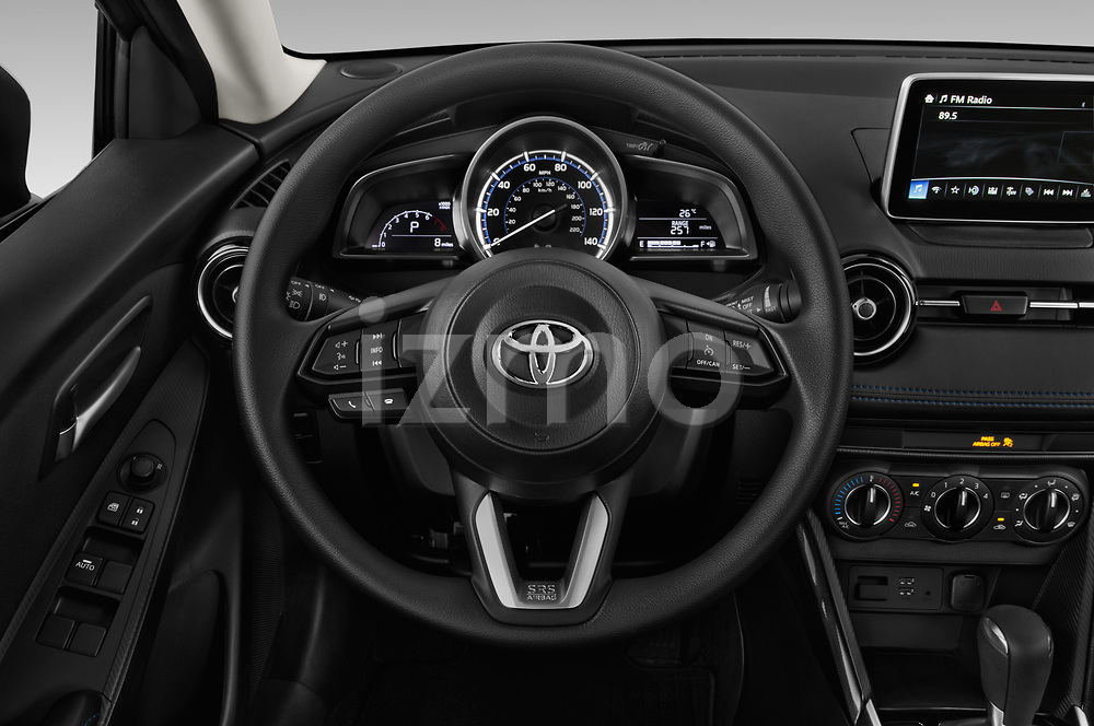 Car pictures of steering wheel view of a 2018 Toyota Yaris LE 4 Door Sedan