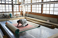 Working on a nearly completed carpet. Oriental Carpet Mills, Yamanobe-machi, Yamagata, Japan, April 12, 2016. Oriental Carpet Mills was founded in 1935 and produces luxury hand-woven and tufted carpets. Its carpets are used all over the world, including in the Vatican, the Imperial Palace in Tokyo and the Kabukiza Kabuki Theatre.