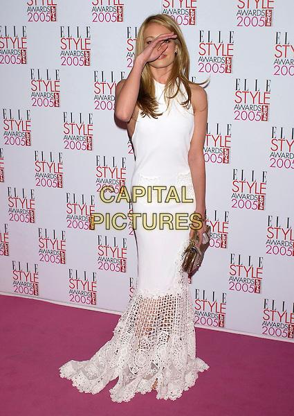 CAT DEELEY.Elle Style Awards 2005,.Spitalfields Market, London, .February 15th 2005..full length white cream dress funny hand over face.Ref: PL.www.capitalpictures.com.sales@capitalpictures.com.©Capital Pictures.