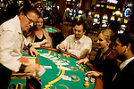 Blackjack table in Las Vegas, Nevada, Caesars Palace and Casino, gaming, gambling, chips, blackjack, betting croupier, blackjack players, model released, blackjack table, cards, NV, Las Vegas, Photo nv241-17427..Copyright: Lee Foster, www.fostertravel.com, 510-549-2202,lee@fostertravel.com