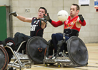 27 MAY 2013 - DONCASTER, GBR - Paul McDerby (right) of the East Midlands Marauders reaches for the ball during the teams 5th / 6th position decider against the Leicester Tigers at the 2013 Great Britain Wheelchair Rugby Nationals at The Dome in Doncaster, South Yorkshire (PHOTO (C) 2013 NIGEL FARROW)