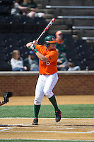 David Thompson (8) of the Miami Hurricanes at bat against the Wake Forest Demon Deacons at Wake Forest Baseball Park on March 22, 2015 in Winston-Salem, North Carolina.  The Demon Deacons defeated the Hurricanes 10-4.  (Brian Westerholt/Four Seam Images)