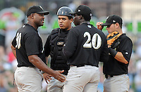 May 27, 2008: Pitching coach Jonathan Hurst, left, of the Savannah Sand Gnats, Class A affiliate of the New York Mets, speaks with starting pitcher Maikel Cleto on the mound during a recent game at Fluor Field in Greenville.Photo by:  Tom Priddy/Four Seam Images