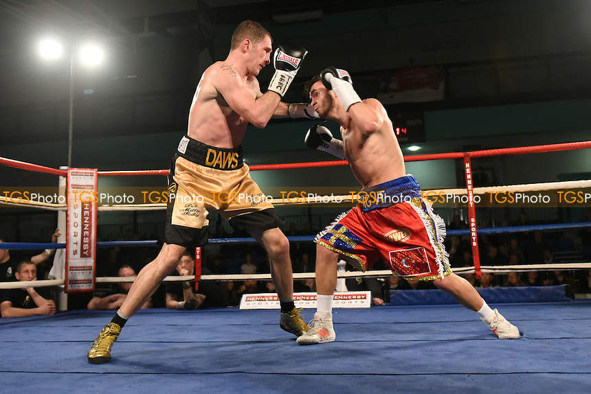 Anthony Yigit (red/blue shorts) defeats Lenny Daws to win the EBU European Super-Lightweight Title during a Boxing Show at the Westcroft Leisure Centre on 11th February 2017