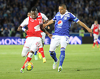 BOGOTA -COLOMBIA- 15 -09-2013. Anderson Zapata ( Der) de Los Millonarios disputa el balón contra Jefferson Cuero (Izq) del Independiente Santa Fe , acción de juego correspondiente al partido  de Los  Millonarios contra el  Independiente  Santa Fe , juego de  la novena fecha de La Liga Postobon segundo semestre jugado en el estadio Nemesio Camacho El Campin / Anderson Shoe (Der) of The Millionaires disputes the ball against Jefferson Cuero (Left) of the Independent Santa Fe, action of game corresponding to the party of The Millionaires against the Independent Santa Fe departed from the ninth date of The League Postobon the second semester played in the stadium Nemesio Camacho The Campin  .Photo: VizzorImage / Felipe Caicedo / Staff