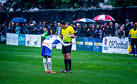 Lautoka's Edward Justin apologises to Referee Kader Zitounir for a foul during the Oceania Football Championship final (first leg) football match between Team Wellington and Lautoka FC at David Farrington Park in Wellington, New Zealand on Sunday, 13 May 2018. Photo: Mike Moran / lintottphoto.co.nz