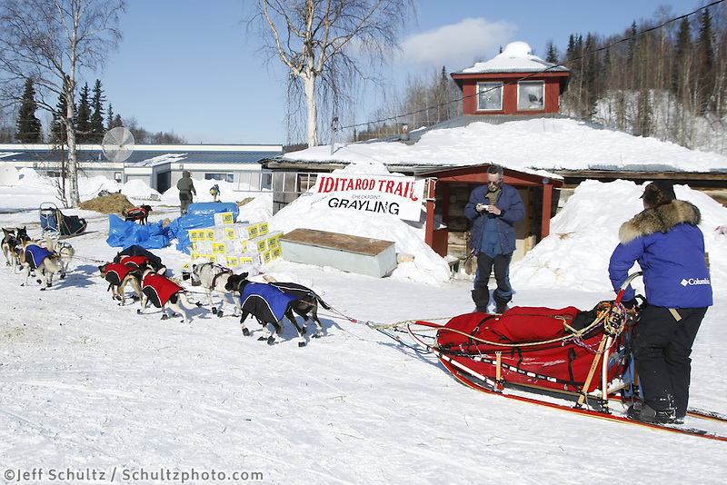 Rachel Scordis checks in at the Grayling checkpoint on Sunday afternoon.  Iditarod 2009