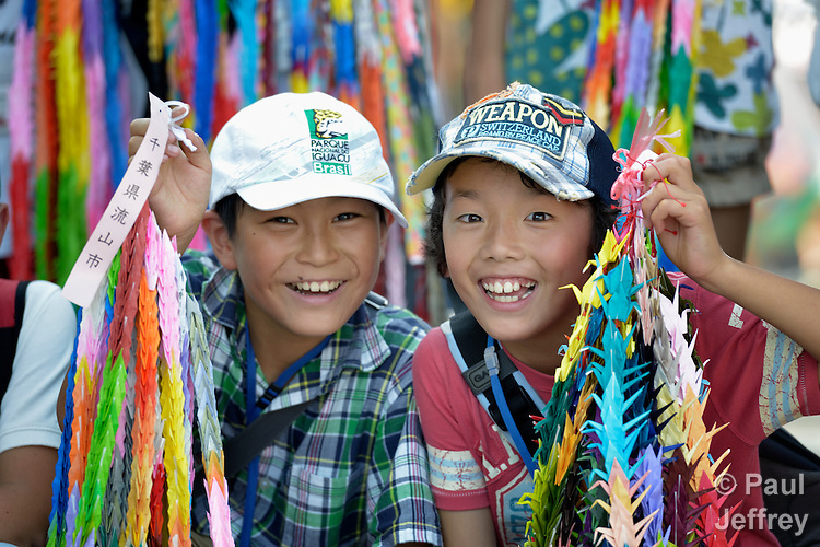 Japanese school children display folded paper cranes they have brought to Hiroshima in commemoration of the 70th anniversary of the U.S. dropping an atomic bomb on the Japanese city of Hiroshima. The cranes are a sign of hope and peace.