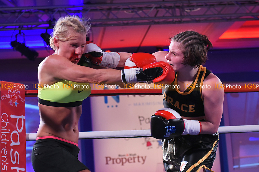 Ashley Brace (R) defeats Petra Castkova during a Boxing Show at the Royal Lancaster Hotel